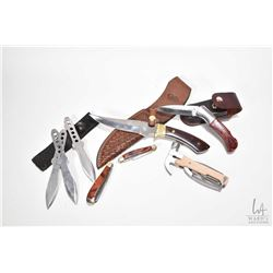 Selection of collectible knives including hunting knife in leather sheath, set of throwing knives, t