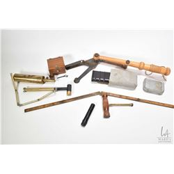 Vintage wood and metal clay pigeon thrower, military style gun cleaning kits, folding tape measures,