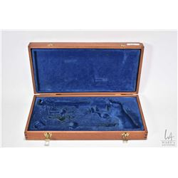 Mahogany box with flocked blue liner for revolver and accessories, believed to be large framed Smith