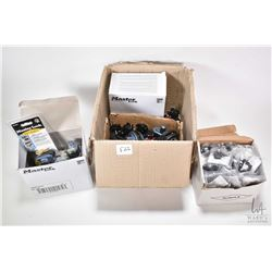 Large selection of trigger locks including new in box Master Lock key lock and a non-keyed trigger l
