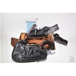 Selection of leather holsters, pouches and belts plus a Browning handgun bag
