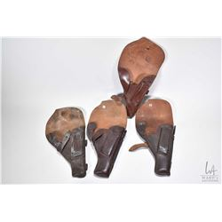 Four Tokarev leather handgun holsters with mag storage and two include cleaning rods.