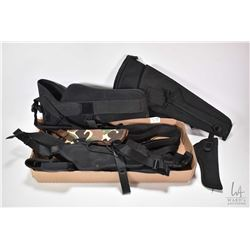 Selection of canvas holsters and gun belts including branded Colt, Kolpin, Sidekick, S&W etc.