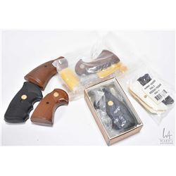Selection of Colt brand grips including four wooden sets, an early factory I frame python set, plast