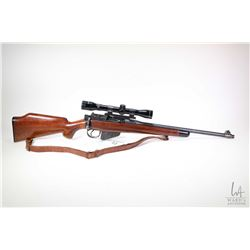 Non-Restricted rifle Lee Enfield model Sporterized, .303 Brit ten shot bolt action, w/ bbl length 18