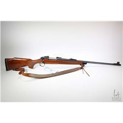 "Non-Restricted rifle Remington model 700, 7mm Rem Mag bolt action, w/ bbl length 24"" [Blued barrel a"