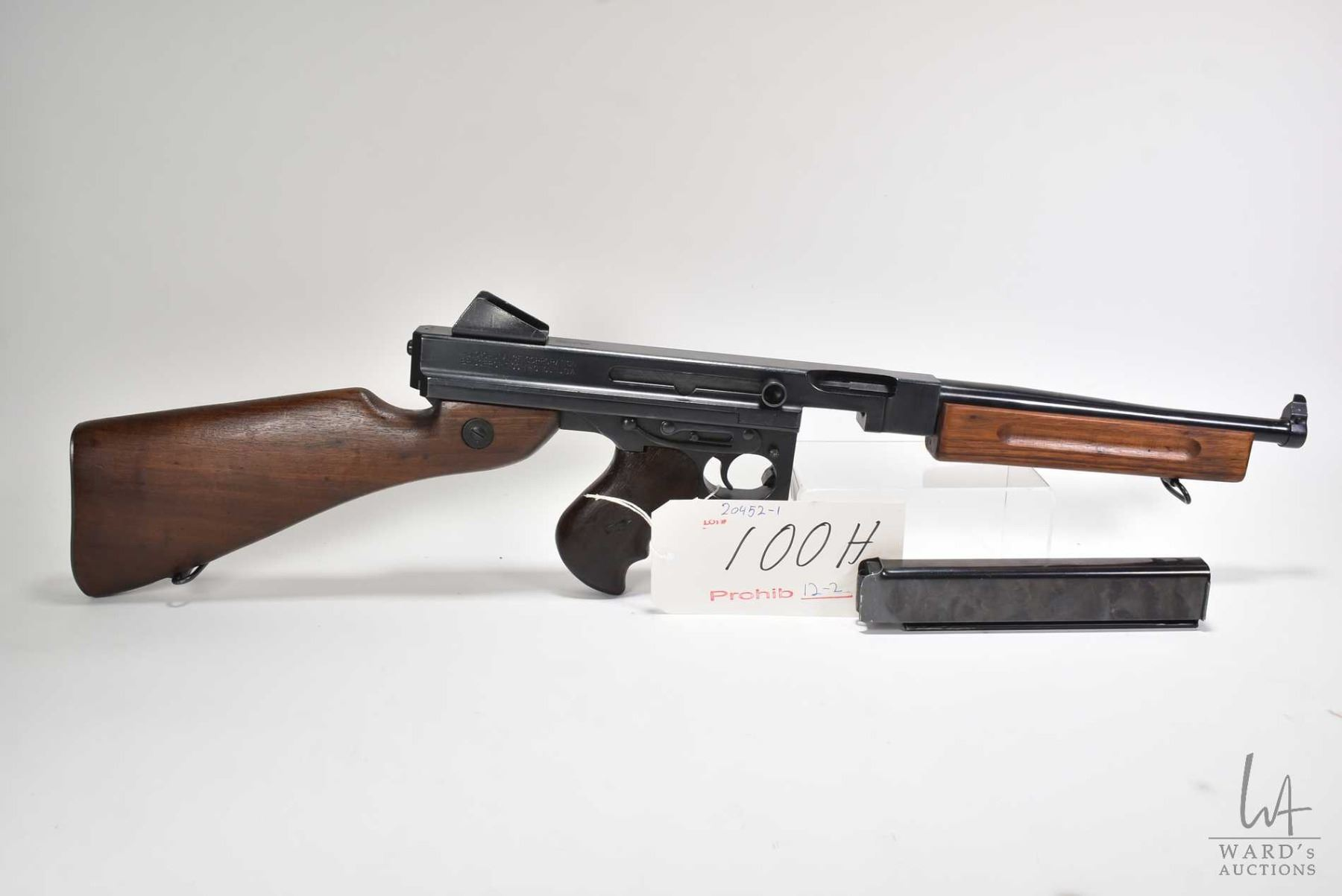 https://www.icollector.com/Prohib-12-2-rifle-Thompson-model-M1A1-45ACP-5-Shot-full-automatic-w-bbl-length-267mm-Blued-barr_i37767787