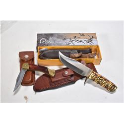 Three collectible knives including a boxed Browning Ducks Unlimited model 521DU with sheath, a Schra