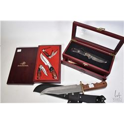 "Three collectible knives including Winchester wooden handled hunting knife with 9"" blade and canvas"