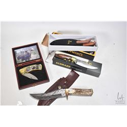 Four collectible knives including a boxed Browning model 322585 two piece combo knives with sheath,