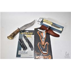 Selection of new in package knives including Schrade knife with sheath, a Schrade folding knife with