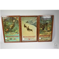 "Three framed vintage Winchester Repeating Arms advertising posters 15"" X 9"" plus framed magazine adv"