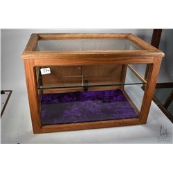 Oak framed showcase/ display cabinet with single glass shelf, glazed top, front and sides plus doubl
