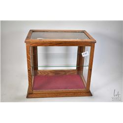 Small antique showcase/retail display cabinet with glazed front, sides and top and single glazed doo