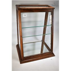 Antique oak wedge shaped showcase/retail display cabinet with glazed top, sides and front with two g