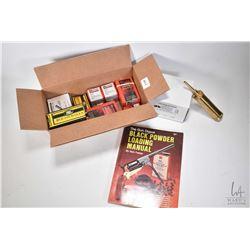 Selection of black powder items including various caliber lead round balls, a brass powder measurer,