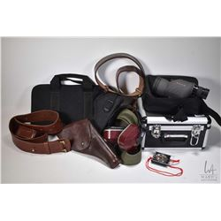 Selection of shooting equipment including a Tasco spotting scope with canvas case and locking hard c
