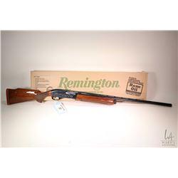 "Non-Restricted shotgun Remington model 1100 Classic Trap, 12 gauge 2 3/4"" semi automatic, w/ bbl len"