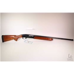 "Non-Restricted shotgun Remington model 1100 LW, 20 gauge 2 3/4"" Magnum semi automatic, w/ bbl length"