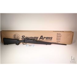 """Non-Restricted rifle Savage Arms model Axis, .22-250 Rem bolt action, w/ bbl length 22"""" [Satin black"""