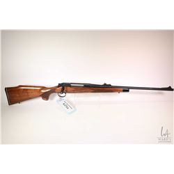 "Non-Restricted rifle Remington model 700, .270 Win bolt action, w/ bbl length 22"" [Blued barrel and"