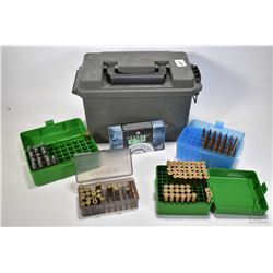 Green plastic ammo. box containing a 20 count box of Federal .303 Win 180 grain, a green ammo. box w
