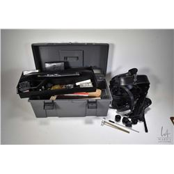 Selection of shooting supplies including gray tool box with assorted speed loaders including Safaril