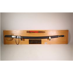 "Wall mounted ""The Pen is Mightier Than The Sword"" display including a 37"" sword in sheath and a 12"""