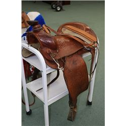 Men's Western Pleasure saddle made by Big Horn Saddlery. Hand carved leather with stock leather seat