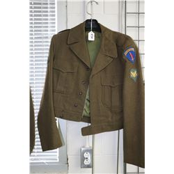 US Army military jacket complete with special forces patches including one for a campaign in Europe.