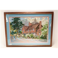 Framed needlework of an English cottage purportedly stitched by a woman wholived on that street, ove