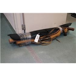 Five soft rifle cases.