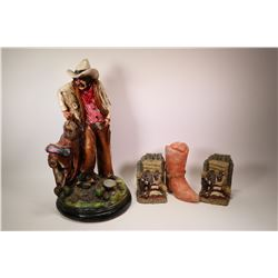 "Ceramic cowboy figure, 21"" in height plus a pair of cowboy motif books ends and a plaster cowboy boo"