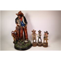 "Ceramic cowboy figure, 21"" in height and three small resin cowboys approximately 10"" in height."