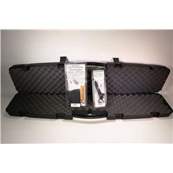 Wolverine hard plastic rifle case, a Remington model 700 detachable magazine new in package and a Re
