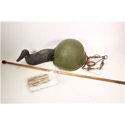Selection of interesting collectibles including WWII metal helmet with camo. cover, four .50 cal dum