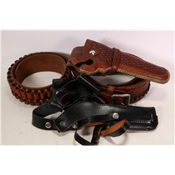 Tooled leather cartridge belt and holster made by Idaho Leather Company, a Hunter 206 sm cartridge b