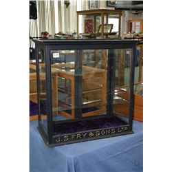 """Antique counter top display cabinet with sliding glass doors and single shelf marked """"J.S. Fry & Son"""