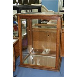 Antique showcase/retail display cabinet with glazed sides, front and top, single shelf and mirrored