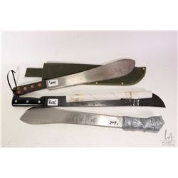 Three machetes, one with canvas sheath.