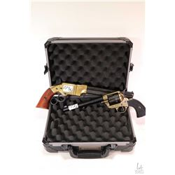 Small Safari foam lined hard case and two faux guns including single action revolver and Volcanic.