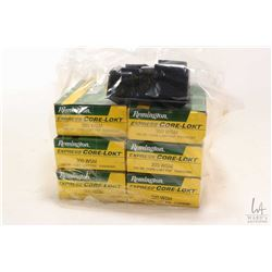 Six 20 count boxes of Remington .300 WSM 150 grain ammunition and metal magazine marked BLR 300 WSM.