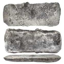 """Silver """"tumbaga"""" bar #M-99, 17.88 lb av, marked with fineness IUCXXV (1125/2400) and two partial tax"""