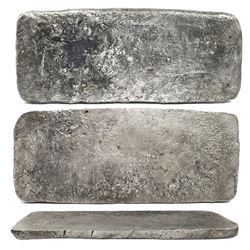 "Silver ""tumbaga"" bar #M-134, 14.63 lb av, marked with fineness IUBLXXV (1575/2400), plus serial numb"