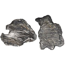 Lot of two small silver  splash  ingots, 189 grams total, ex-1733 Fleet.