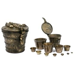 Massive, complete, eight-pound nesting cup-weight set (including case), stamped with bow-and-arrow m