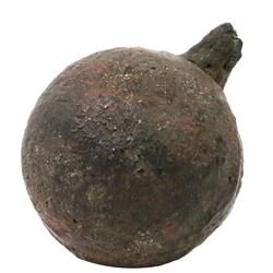 Small iron cannonball grenade (three-pounder) with fuse intact, 1700s.