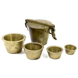 Set of brass nested cup-weights in lidded case (16 oz), probably made in Nuremberg, Germany, in the