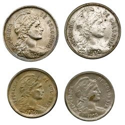 Lot of four Colombia, copper-nickel papel moneda coins: 2 pesos, 1907 and 1914; 1 peso, 1910 and 191