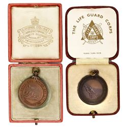 Lot of two Great Britain Royal Life Saving Society bronze medals in original presentation boxes, eng